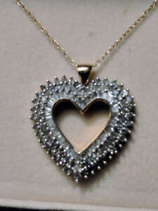 Round and Baguette Diamond Heart Pendant.