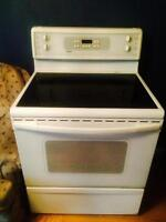 1.5 year old kenmore white flat top stove for sale