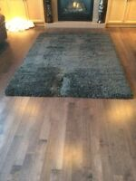 Brand new Grey shag rug from Costco. Made in  Belgium. $100 FIRM