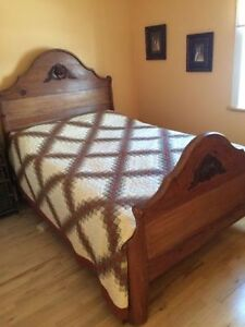 Antique double bed frame. Comes with mattress and box spring!