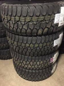 4 new  LT 33x12.50x17 AMP TERRAIN GRIPPER 10 Ply tires installed and balanced