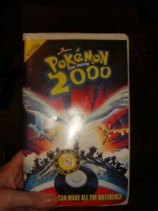 Pokemon Lot Pokemon Rare VHS With Coin, Dish, Keychains, Table