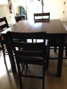 pub table and four chairs like new