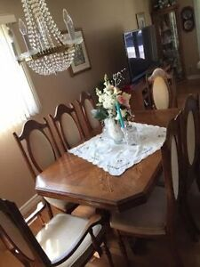 10-seater oak dining table and china cabinet