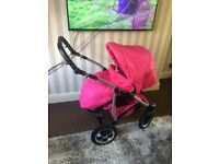Very bright pink 3 in 1 pushchair