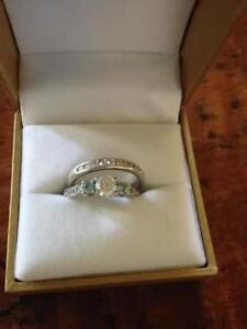 Beautiful engagement ring and band with blue diamonds and certif