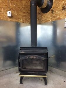 Wood stove with complete chimney set up.