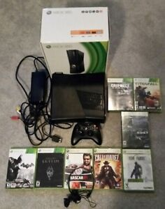 XBOX 360 Slim 320gb, 1 controller, headset, and 8 games