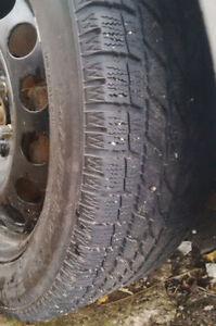Four new VW 5x100 factory rims with 205/55R16 winter tires $320