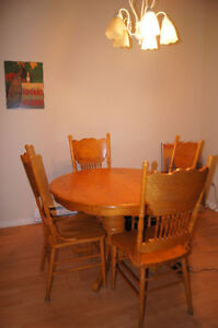Solid Oak dining table with leaf & 4 chairs