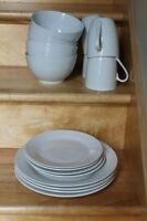 Set of 4 matching white dishes in excellent condition