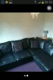 Lage black left hand corner leather sofa