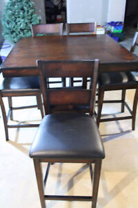 Pub table and five chairs! Originally $1200 from the brick