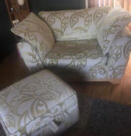 Large cream and green armchair with matching storage pouffe