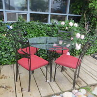 GLASS TOP,ROD IRON TABLE 4 CHAIRS