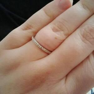 10 kt white gold, .12 ct weight diamond wedding band