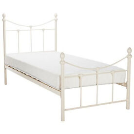 Girl's white metal bed and mattress.