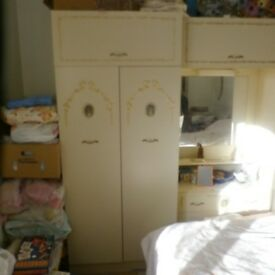 Cream bedroom wardrobe and dressing furniture set.