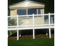 DE-LUXE CARAVAN WITH BALCONY AND PRIVATE PARKING AT JUNIPER CLOSE SANDY BAY DEVON CLIFFS EXMOUTH