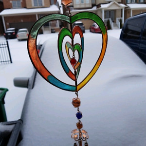 Large wind chimes.  Star & Heart designs
