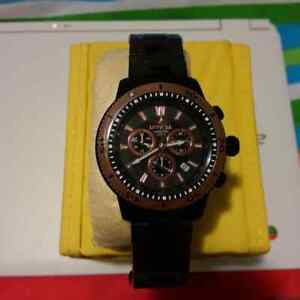Brand new men classy watch in box with papers worth $600US.