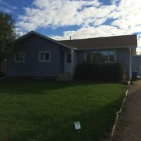 Red Key Realty ~ PM 702 ~ PENHOLD 4 Bedroom Bungalow with Garage