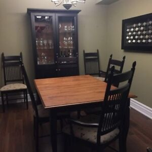 Dining table with 7 chairs and hutch just $900.00