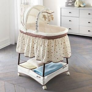 Gliding Bassinet with mobile, music, light, vibration, storage