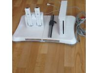 Nintendo wii console and wii fit board plus games and controllers
