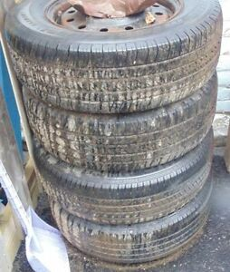 Set of 4 215 70 15 tires with rims