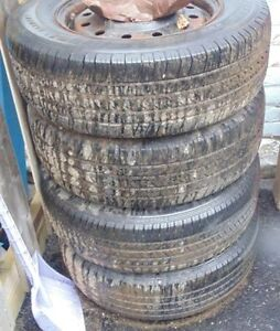 4 tires with steel rims, 215 70 15 ford steel rims