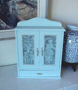 Small Pale Blue Cabinet w/ Picking Apples Lace Covered Doors
