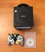 Nintendo GameCube with Gameboy Player and startup disk