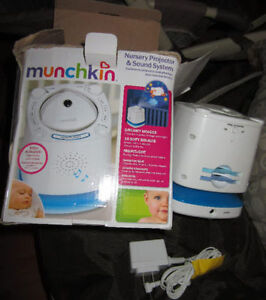 Munchkin Nursery light with lullabies, white noise, rain, etc.