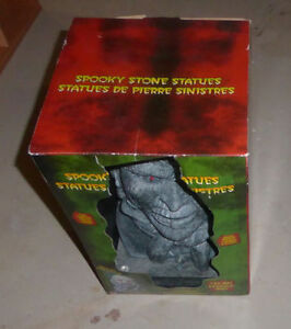 NEW in Box spooky stone statue, skeleton dog $ 10 ea, both $ 15