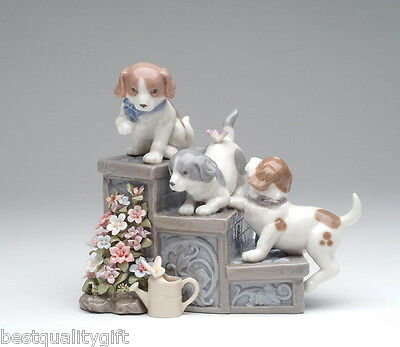 """COLLECTIBLE PORCELAIN THREE PUPPIES ON GARDEN STEPS,DOGS """" PUPPY LOVE"""" MUSIC BOX"""