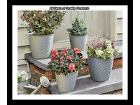 Set Of 4 Round Grey Planters