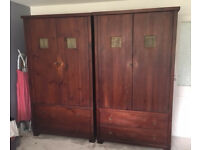 Matching wardrobes in good condition made of dark stained pine