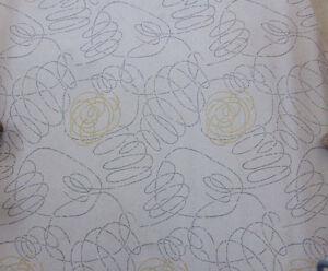 50er Jahre Tapete, graue und gelbe Linien Kringel auf weißem Grund