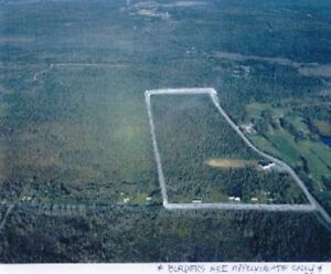 88 ACRES NEAR AIRLANE GOLF COURSE BEHIND AIRPORT