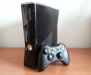 Xbox 360 slim Like New, 500 gb hard disk built in, 11 games