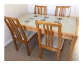 Dining table and four chairs for sale