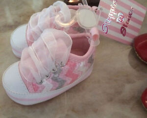 FS: Baby girl shoes . Sz 0-3 months