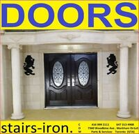 Cast Stone Entry + Fiberglass wood grain Door with Wrought Iron
