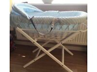 Blue and white wicker Moses basket