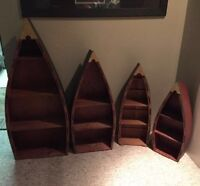 Looking for canoe shelves.Any size.Or a cheap large wooden canoe