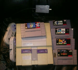 Super Nintendo - SNES - with 2 controllers and 5 Games