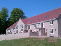 STUNNING ground floor apartment, 'over 55's' set in private grounds. Village location on bus route.