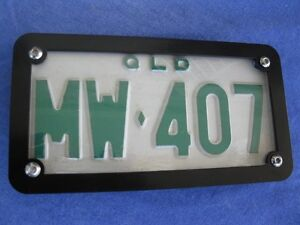 Motorcycle-number-plate-frame-surround-with-clear-lens-Honda-Triumph-ect
