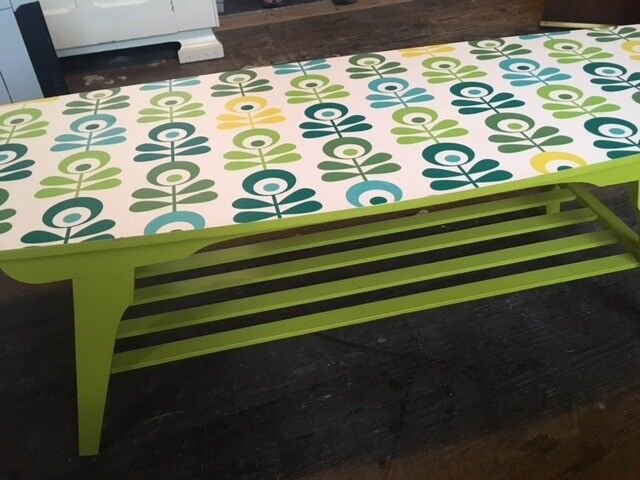 Genuine retro coffee table with slatted shelf and wipeable top, wood veneer painted lime green
